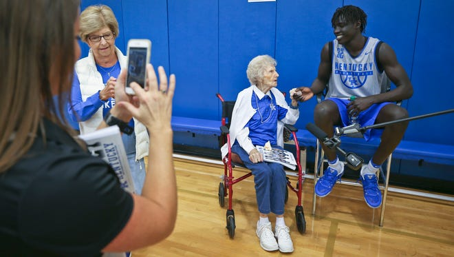 Kentucky's Wenyen Gabriel holds Mildred Waite's hand as the two chat during Media Day in Lexington.