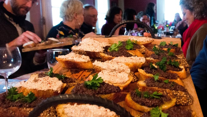 Diners at a recent dinner at Agricola Farm in Panton, with the first course of olive, citrus Tapenade and a wild mushroom, walnut pâté on crispy bread.