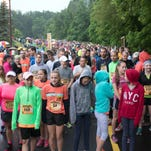 5K participants brave the cold rain as they line up at the start / finish line prior to the Cheetah Chase event held at Binder Park Zoo Saturday morning