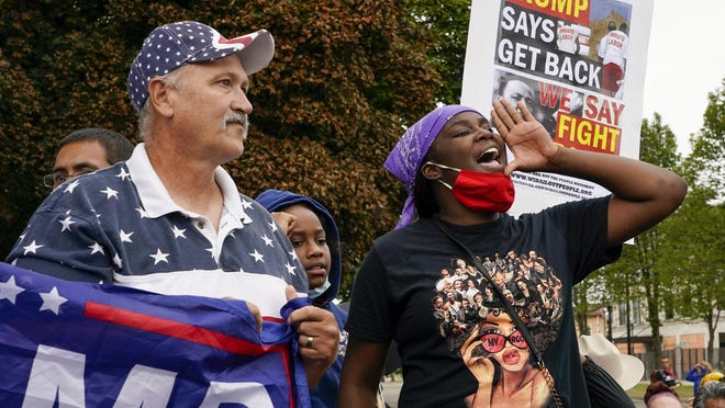 Supporters of both President Donald Trump and Black Lives Matters protest in a park outside the Kenosha County Courthouse.