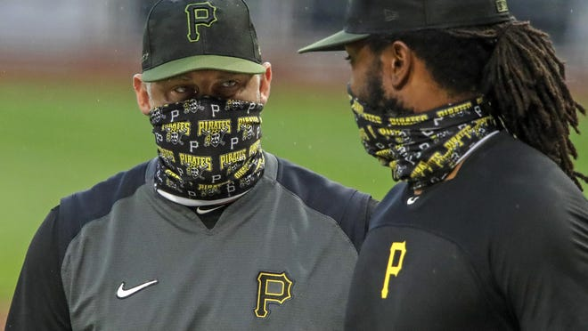 In this July 7 file photo, Pittsburgh Pirates first baseman Josh Bell, right, listens to manager Derek Shelton during a team workout at PNC Park in Pittsburgh. Shelton and other first-year managers are scrambling to make up for lost time. The rookie skippers are getting creative when it comes to getting a feel for their players during a season unlike any other.