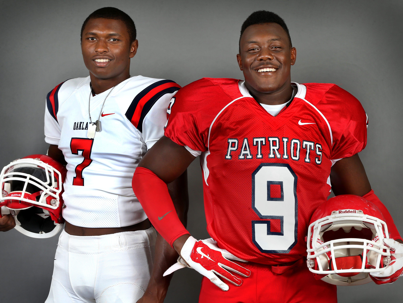 Oakland junior JaCoby Stevens (left) and senior Ty Nix