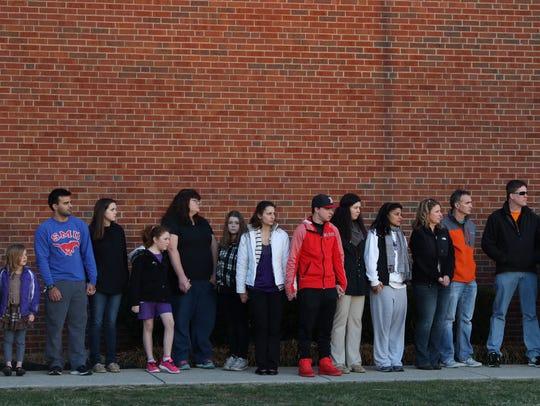 People gather outside of Madison Jr/Sr High School