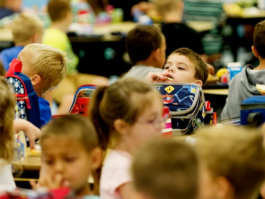 Kids eat their lunches at Gibbs Elementary School in Corryton, Tennessee on Tuesday, September 5, 2017. Knox County Schools has worked to reduce sodium content and increase whole grains in school lunches as well as offering more vegetables and fruits .