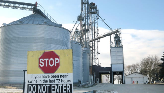 In this Dec. 14, 2016 photo, a sign warns visitors, as disease is a major concern for the Spronk Brothers hog farm near Edgerton in southwest Minnesota. Starting January 1, they and other U.S. livestock producers will have to comply with new federal rules designed to reduce the use of antibiotics in farm animals. (Mark Steil/Minnesota Public Radio via AP)
