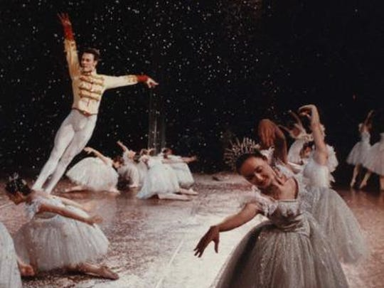 """Dancers dressed as snowflakes and the Nutcracker Prince, portrayed by Clinton Luckett, performed in the first act of """"The Nutcracker"""" at the Louisville Ballet's dress rehearsal.   Photo by John Rott, THE COURIER-JOURNAL Dec 11 1992"""