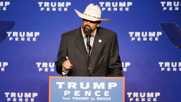 Milwaukee County Sheriff David A. Clarke Jr. speaks before Republican presidential nominee Donald Trump during a rally at the KI Convention Center in Green Bay.