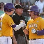 LSU's Beau Jordan, right celebrates the tying run in the ninth inning with Danny Zardon, (27) during their game at Mississippi State on Saturday.