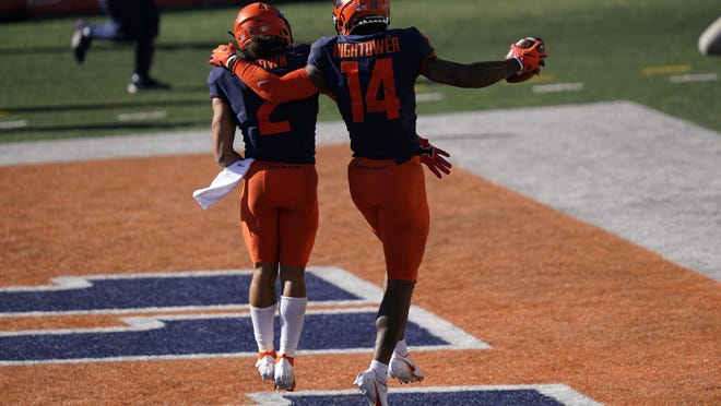 Illinois wide receiver Brian Hightower (14) and Chase Brown celebrate a touchdown during the second half against Purdue Saturday, Oct. 31 in Champaign.