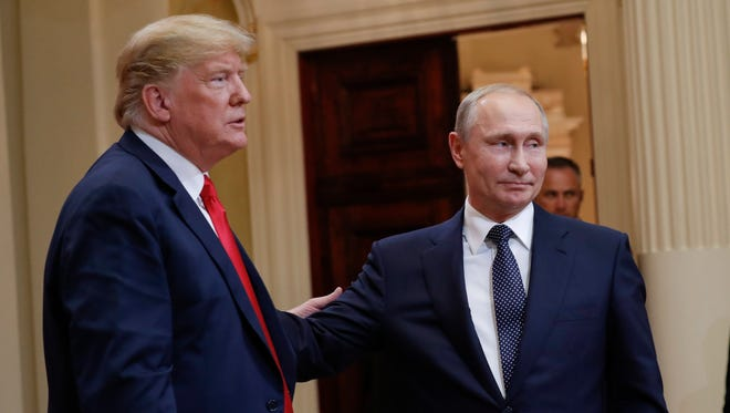 President Donald Trump, left,  and Russian President Vladimir Putin leave the stage together at the conclusion of their joint news conference at the Presidential Palace in Helsinki.