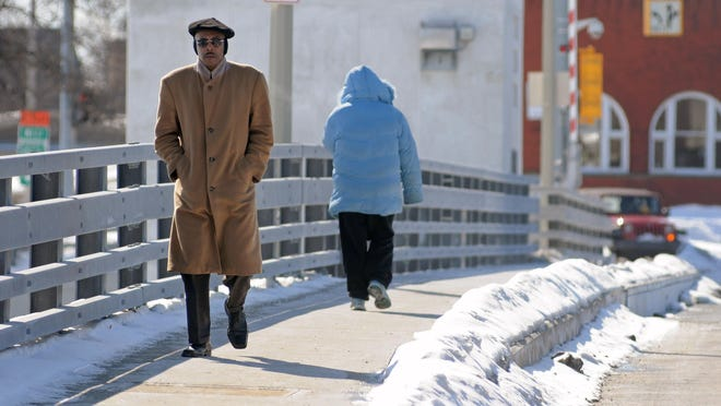 Warren Howard, of Port Huron, crosses the Seventh Street Bridge during a cold snap in 2014.