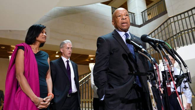 Former Clinton aide Cheryl Mills, left, and House Select Committee on Benghazi Chairman Trey Gowdy, R-S.C., second from left, listen as ranking member Elijah Cummings, D-Md., speaks to reporters on Capitol Hill on Sept. 3, 2015.