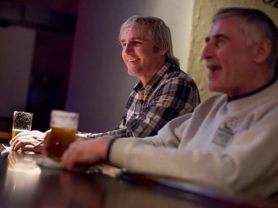 Owner Tom Pellerito, of St. Clair, laughs while having a drink along with Mike Bachler, of Port Huron, Saturday, Jan. 16, 2016 at The Alley Room, 409 Quay St., in Port Huron.
