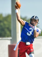 Quarterback Jordan Davis throws on the first day of