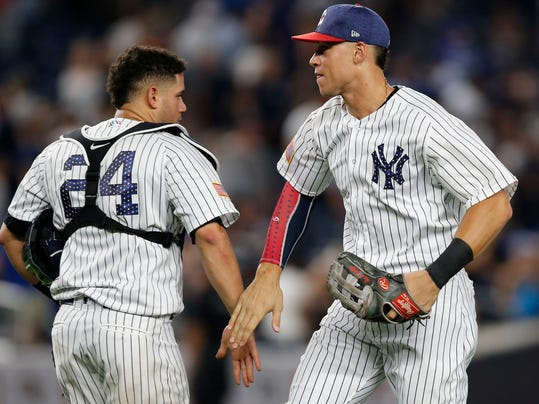 New York Yankees catcher Gary Sanchez (24) and Yankees right fielder Aaron Judge celebrate after the Yankees defeated the Toronto Blue Jays 6-3 in a baseball game in New York, Monday, July 3, 2017. Both Sanchez and Judge will participate in the All-Star Home Run Derby July 10th in Miami, it was announced Monday. (AP Photo/Kathy Willens)