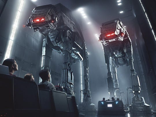 This rendering shows people on the planned Star Wars: Rise of the Resistance attraction, part of Star Wars: Galaxy's Edge. The 14-acre area set to open this summer at the Disneyland Resort in Anaheim, California, then in the fall at Disney's Hollywood Studios in Orlando, Florida.
