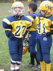 Chase Fee (22) and Jeff Szatkowski as Pop Warner teammates