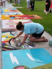 Paige Bootz works on a portrait at Chalkfest 2015 in downtown Wausau.