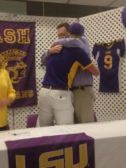 ASH pitcher Matthew Beck (left) hugs his father Thursday.