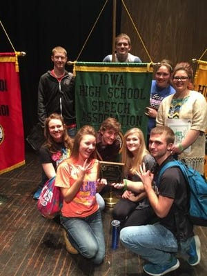 Critics Choice Choral Reading team with the championship banner and plaque include: on the floor - Allison Wheeler, Ciara Hirsch, Jude Teumer, Shelby Helm and Grant Johnson. Standing - Vance Bushong, Shane Helm, Breck Goodman and Kennedy Phillips. Absent for photo - Tyler Geiger, Jordon Bender