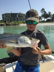 Nine-year-old Trey Hill of Naples landed and released a nice Snook right close to the beach, with a blue runner and a small circle hook.