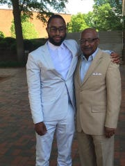 Colin Chambers and his father, Gregory, after the younger man graduated from Howard University.