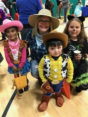 YMCA of Vineland staffer Ashley Parent poses with children at the YMCA's Spooktacular.