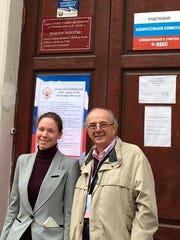 St. Petersburg, Russia resident and Team Interpreter Yakaterina Yeremeyeva and Observer Hooper Penuel in front of Polling Place in St. Petersburg, Russia.
