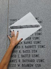 Tammi Thomas etched her brother's name from a memorial