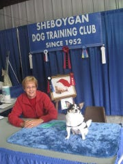 "Judy Triplett and her dog ""Bruizer"" volunteered at the Sheboygan Dog and Training Club booth to promote upcoming dog training classes."