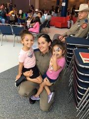 DPS Trooper Mychelle Andrews Montoya assists evacuees