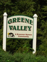 The sign for the former Greene Valley Estates development project on Wooley Road stands alongside the road on Aug. 8, 2007.