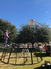 Carlsbad-based The Light Shed LLC assembled the 30-foot Christmas tree on the courthouse lawn of Fifth Judicial District Court. It took the company about half a day to put the tree together.