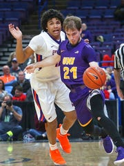 Evansville's Dru Smith collides with Northern Iowa's Hunter Rhodes during an NCAA college basketball game in the Missouri Valley Conference men's tournament Thursday, March 1, 2018, in St. Louis. (J.B. Forbes/St. Louis Post-Dispatch via AP)