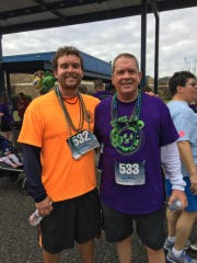 John Waldron and his son Ian after a recent 5K race.