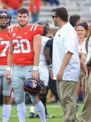 Shea Patterson on the field with Sean at Ole Miss.