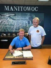 Manitowoc Mayor Justin Nickels (left) and Command Sgt.