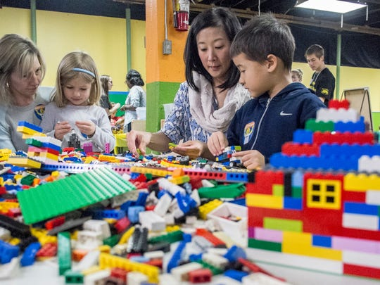 Lisa Beardslee, left, and her daughter, Ali, 5, build with LEGOS along with Karen Cronk and her son, Cooper, 6, at LEGO Palooza at Impression Five Science Center January 25, 2015.