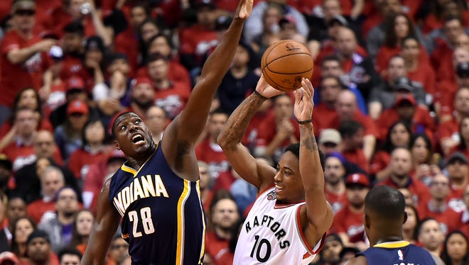 Toronto Raptors guard DeMar DeRozan (10) tries for a shot as Indiana Pacers center Ian Mahinmi (28) defends in game seven of the first round of the 2016 NBA Playoffs at Air Canada Centre.