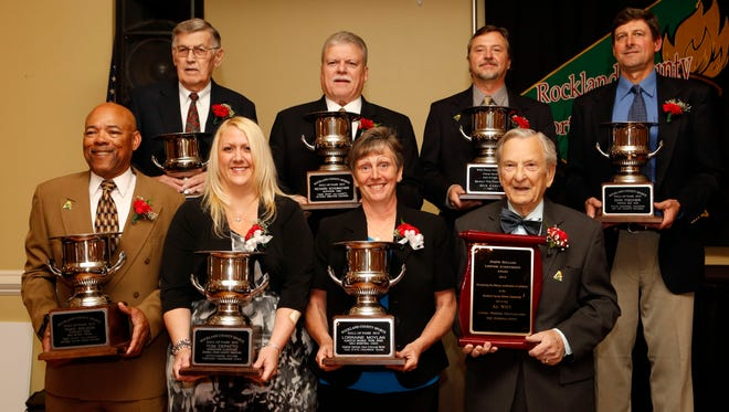 Inductees top row from left: Ed Kolakowski, Richard Schumacher, Rick Carey and Don Fisher. Bottom row from left: Thaddeus Wilson; LewAnn Tonna, daughter of Tom DePatto; Lorraine Moylan; and Al Witt at the Rockland County Sports Hall of Fame induction gala, April 26, 2014 at the Pearl River Elks Club in Nanuet.