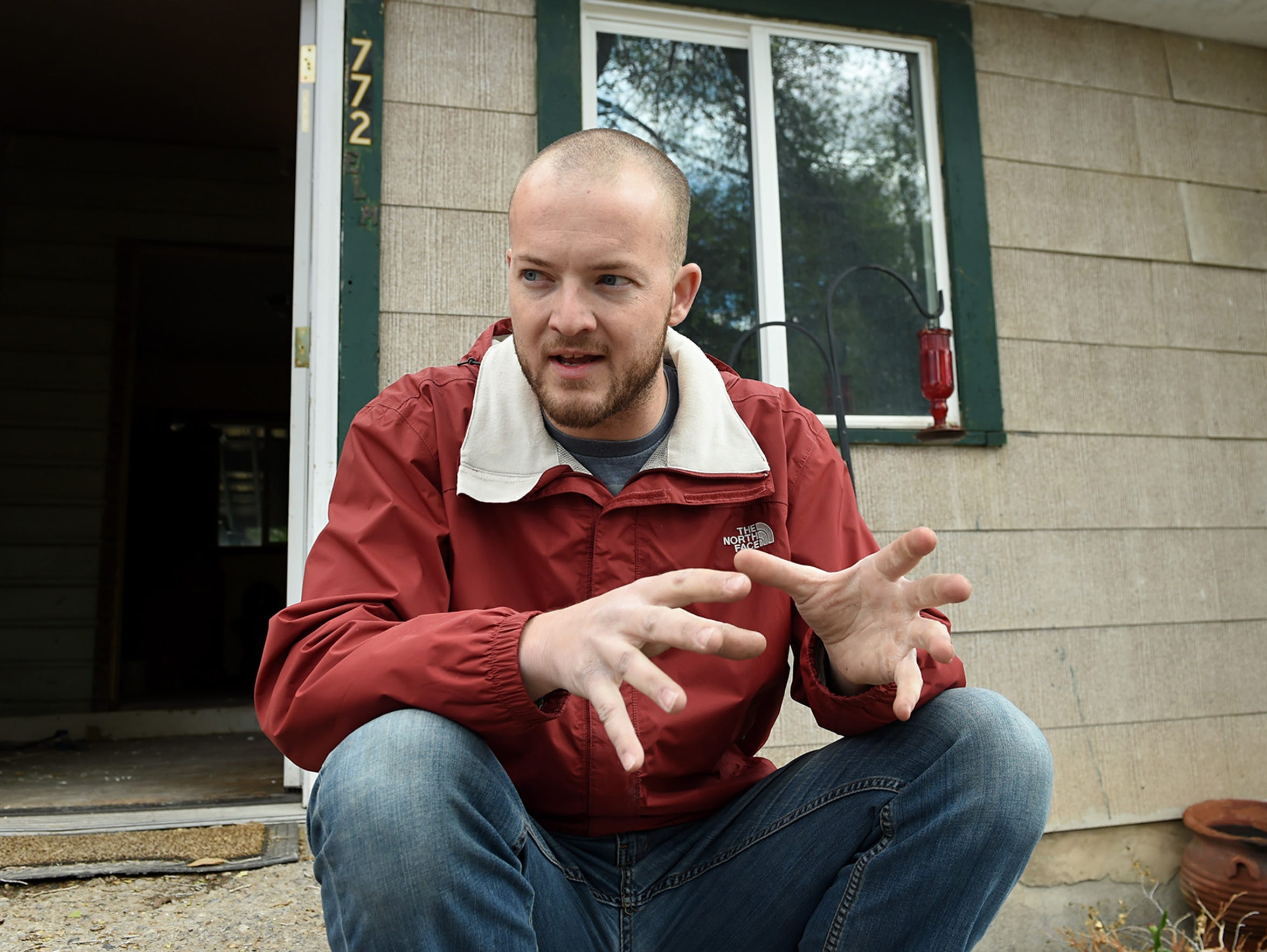 Don Knight, a miner in Elko, sits outside of a house