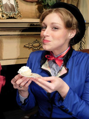 Samantha Trapp, who will play Mary Poppins in the Fremont Community Theatre production, enjoys a specially made Spoonful of Raspberry Filling Cupcake.