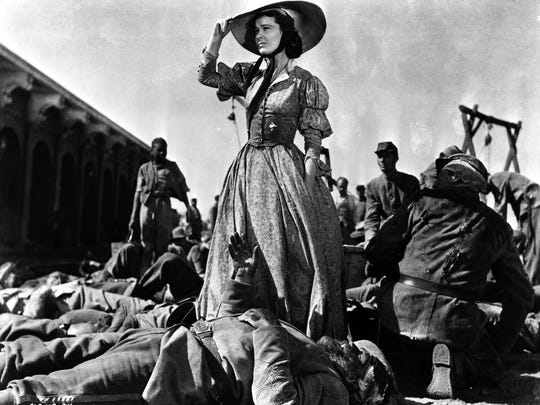 "Vivien Leigh, as Scarlett O'Hara, looks over Civil War wounded in Atlanta. ""Gone With the Wind"" is marking its 75th year, with special showings of the movie slated in coming days at Carmike Cinemas Avenue 16 in Melbourne."