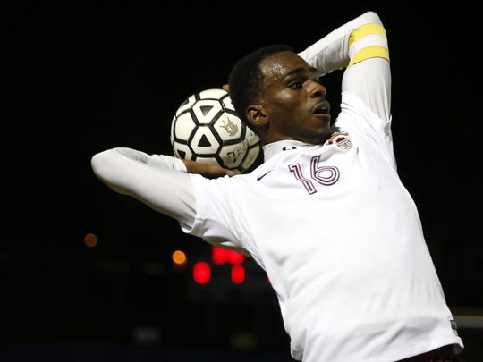 Florida High's Michael Williams Jr throws the ball in to play during their District Semifinal game against Marianna at Rickards High School on Wednesday.