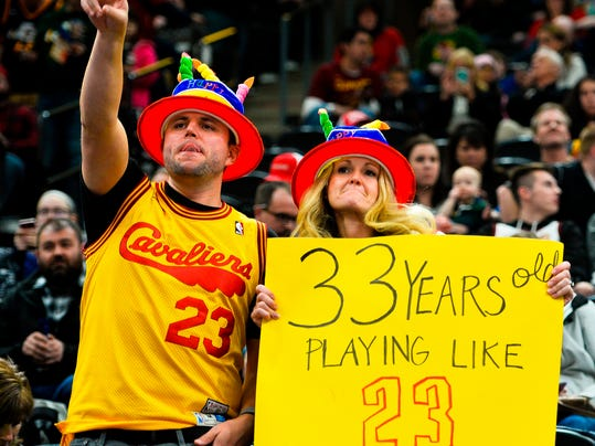 FILE - In this Dec. 30, 2017, file photo, fans hold up a sign celebrating Cleveland Cavaliers forward LeBron James' birthday before an NBA basketball game against the Utah Jazz, in Salt Lake City. At 33, an age when athletes are either eroding, completely washed up or staring retirement straight in the eyes, James is flourishing with zero signs of decline. (AP Photo/Alex Goodlett, File)