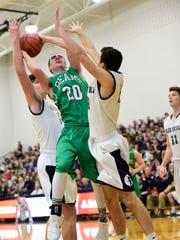 Margaretta's Nick Leibacher, middle, slices between
