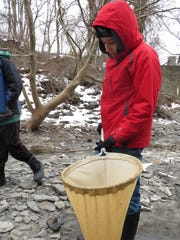 Orion Peck, a 12-year-old 6th grader, adds water containing