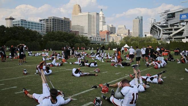 The Cincinnati Bengals stretch out after practice during training camp at the Paul Brown Stadium practice field in downtown Cincinnati on Tuesday, Aug. 2, 2016.