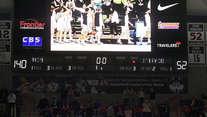 The scoreboard at the University of Connecticut displays the final score.