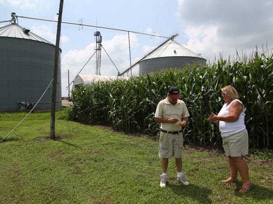 Kelly and Gina Bennett check corn on Wednesday afternoon, Aug. 3, 2016, at the Bennett's farm in rural Keota. The farm has been in the family for six generations.